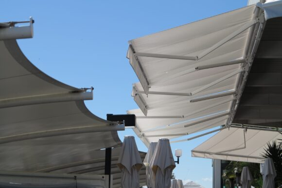 white folding arm awnings